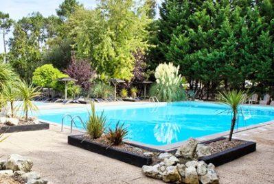 CASTEL / LE VILLAGE WESTERN-La piscine du camping CASTEL / LE VILLAGE WESTERN-HOURTIN